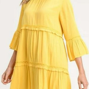 Tiered dress with bell sleeves in mustard.